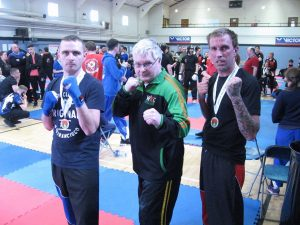 Two fighters with Brendan Donnelly 8th Dan Karate and kick boxing instructor