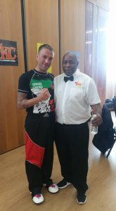 Sensei Donnlly's Stydent Ian Warren picture with Ronnie Green 6 times World Muay Thai Champion